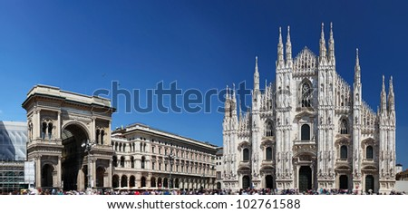 Piazza del Duomo in Milan, Italy, with Duomo (on the right) and the arch that marks the entrance to Galleria Vittorio Emanuele II (on the left) - stock photo