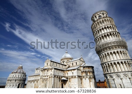 Piazza del Duomo (Piazza dei Miracoli) with famous landmarks of Pisa - Duomo cathedral, leaning tower and baptistery. It is UNESCO World Heritage Site. - stock photo