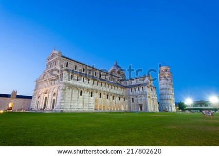 Piazza del Duomo with Pisa tower and the Cathedral illuminated at night, Pisa, Italy - stock photo