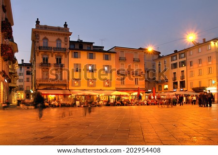 Piazza della Riforma, filled with cafes and restaurants, is the social hub of Lugano's historic center. Lugano, is one of the major cities of the southern Switzerland - Ticino canton. - stock photo