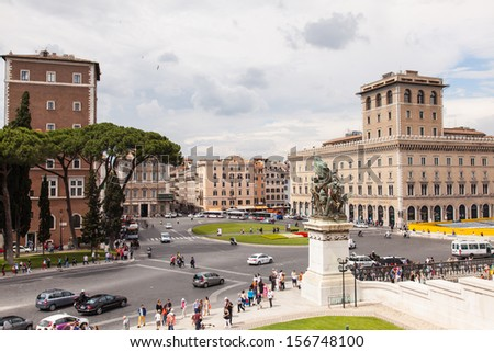 Piazza Venezia is a major circus and the central hub of Rome, Italy, in which many thoroughfares intersect, like Via dei Fori Imperiali and Via del Corso. - stock photo