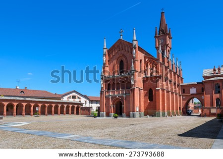 Piazza Vittorio-Emmanuele and Neo-Gothic church of Saint Victor (San Vittore) in town of Pollenzo, Italy. - stock photo