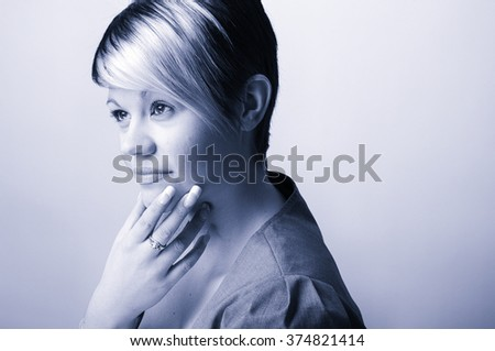 Pic Cool blue toned  Shot of a Confident Young Office Woman . Plain Wall with Copy Space