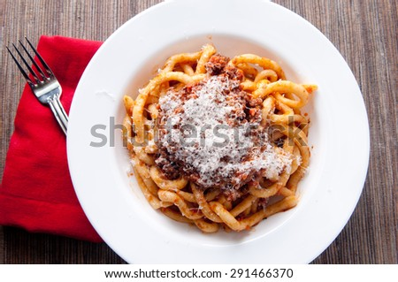 pici pasta with lamb ragu and parmesan cheese