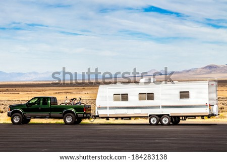 pick up truck  with RV travel trailer on the road - stock photo