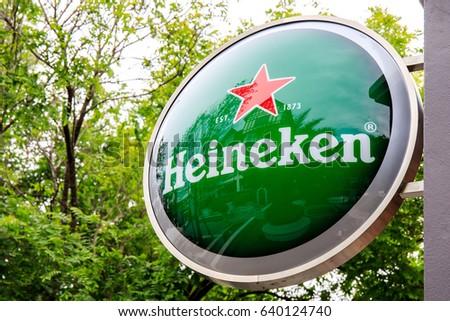 Pickadaily, Bangkok, Thailand. - May 14, 2017 : Heineken logo hang on the wall building.