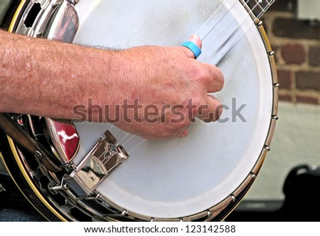 Picking a Banjo - stock photo