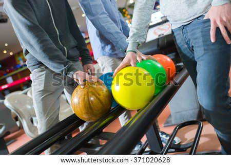 picking bowling balls - stock photo
