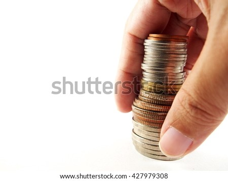 Picking up coins in hand, collected upright coins money, isolated on white background