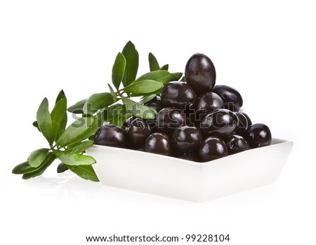 Pickle black olives in a bowl and olive tree branch on a white background - stock photo