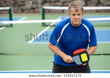 Pickleball player on an outside court - stock photo