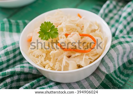 Pickled cabbage on a   light wooden background