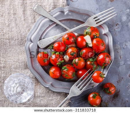 Pickled cherry tomatoes.selective focus - stock photo