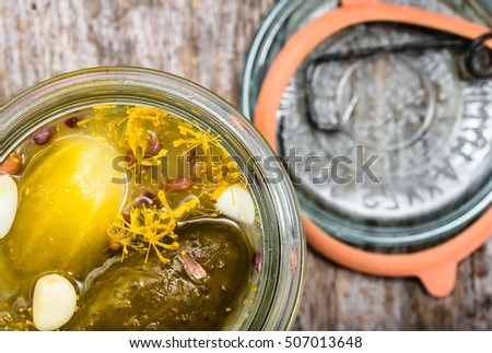 Pickled cucumber in jar. Pickle homemade, food preserves on wooden background, overhead view