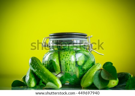 pickled cucumbers with spices in glass jar