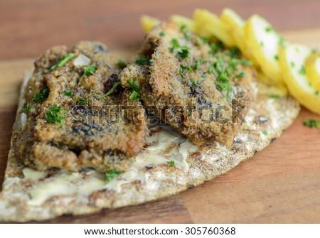 Pickled fried herring on crispbread - stock photo
