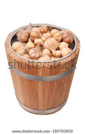 Pickled garlic in a barrel - stock photo