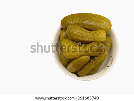 Pickled gherkins in a small white plate isolated on white - stock photo