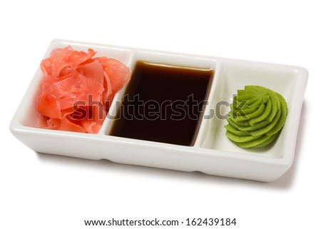 Pickled ginger with soy sauce and wasabi for sushi. Isolated on white. - stock photo