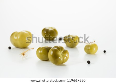 Pickled green tomatoes with spices