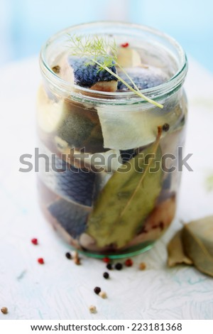 Pickled herring slices, homemade, spicy snack - stock photo