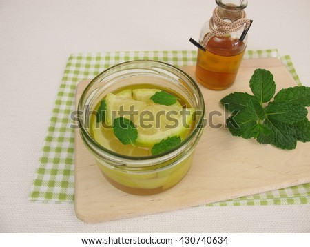 Pickled lemons with mint in vinegar