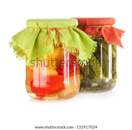 Pickled paprika and cucumber isolated on white background - stock photo