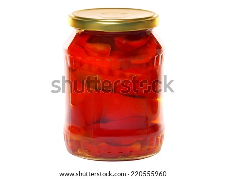 Pickled pepper in a glass jar - stock photo