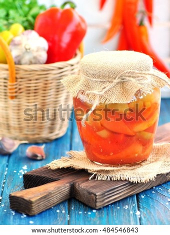Pickled peppers in tomato juice with onions, garlic and basil.