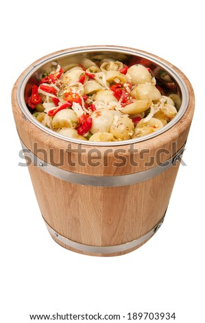 Pickled tomatoes in a barrel - stock photo