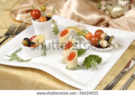 pickled vegetable on the white plate and gold cloth