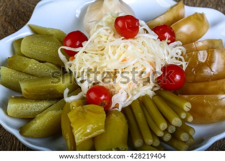 Pickled vegetables - cucumber, tomato, pepper, cabbage - stock photo