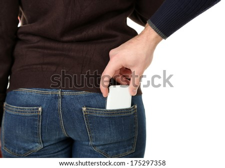 Pickpocket are stealing mobile phone from back pocket, close up, isolated on white - stock photo