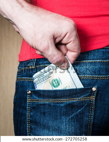 Pickpocket stealing woman money from back pocket closeup. - stock photo