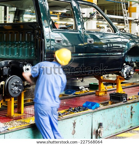 Pickup truck production line, workers are working. - stock photo