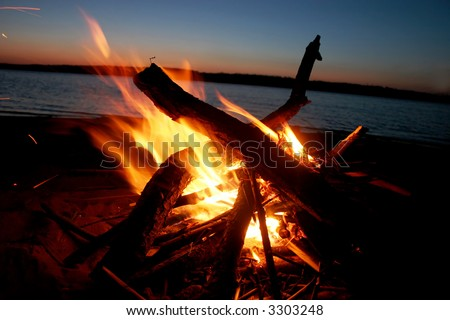 Picnic. A fire on coast of the river - stock photo