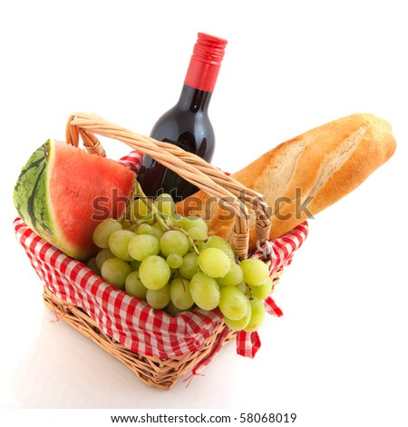 Picnic basket filled with healthy food and wine