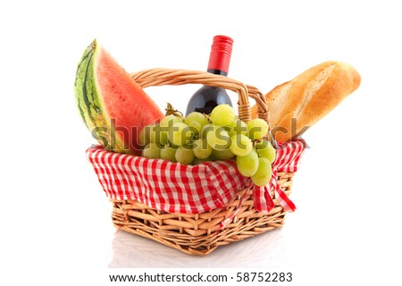Picnic basket filled with healthy food and wine - stock photo
