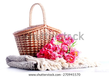 picnic basket full of pink tulips - food and drink - stock photo