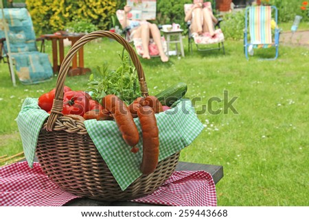 picnic basket in the garden - stock photo