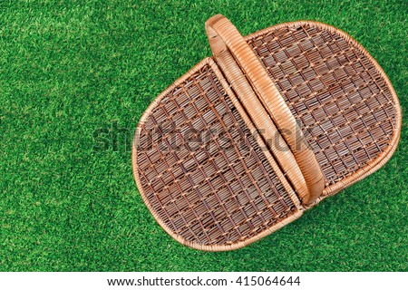 Picnic Basket On The Summer Lawn, Top View, Close Up - stock photo