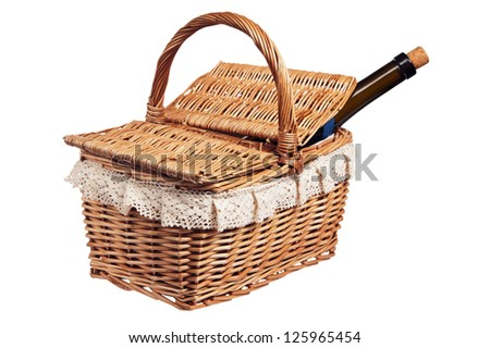 Picnic basket with a bottle of wine, isolated on white - stock photo