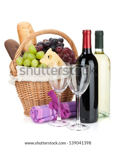 Picnic basket with bread, cheese, grape and wine bottles. Isolated on white background - stock photo