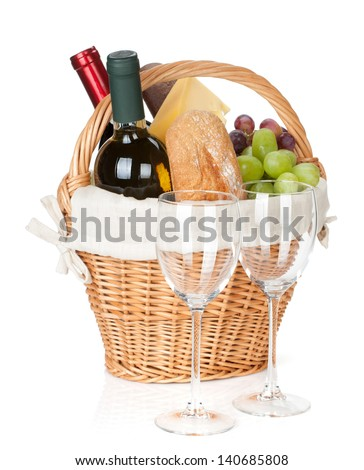 Picnic basket with bread, cheese, grape, wine bottles and two glasses. Isolated on white background - stock photo