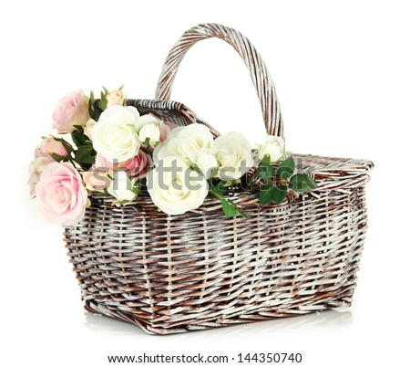 Picnic basket with flowers, isolated on white - stock photo