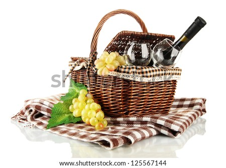 Picnic basket with fruits and bottle of wine isolated on white - stock photo