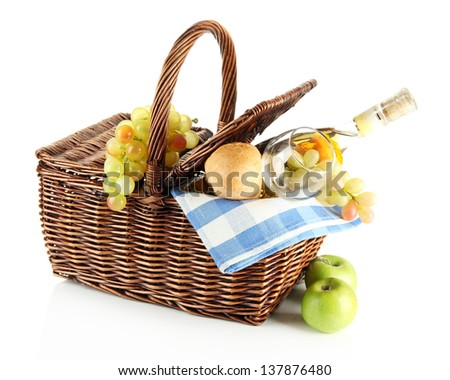Picnic basket with fruits and bottle of wine, isolated on white - stock photo