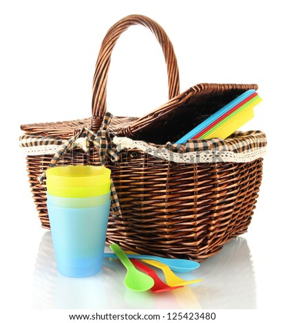 Picnic basket with fruits and  tableware isolated on white - stock photo