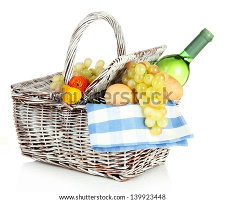 Picnic basket with grape and bottle of wine, isolated on white - stock photo