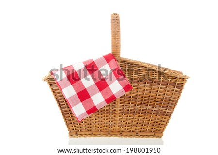 Picnic basket with red checked napkin isolated over white background - stock photo